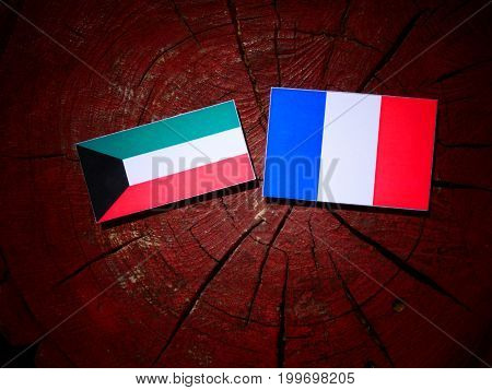 Kuwaiti Flag With French Flag On A Tree Stump Isolated