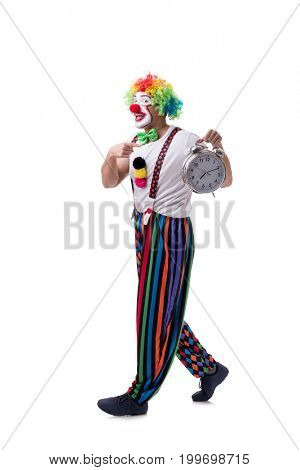 Funny clown with an alarm clock isolated on white background