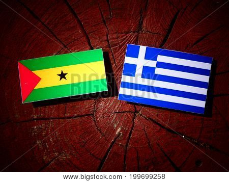 Sao Tome And Principe Flag With Greek Flag On A Tree Stump Isolated