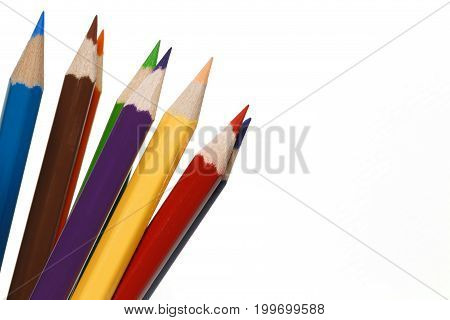 Close-up color pencils isolated on white background concept of art and education.