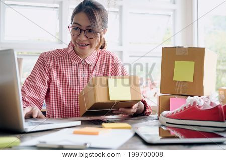 Online Seller Owner Using Computer For Checking Customer Orders.