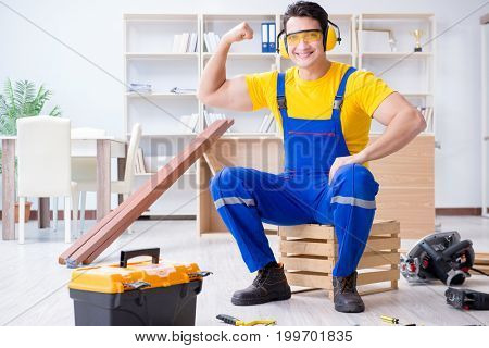 Repairman carpenter working with wooden plank planks