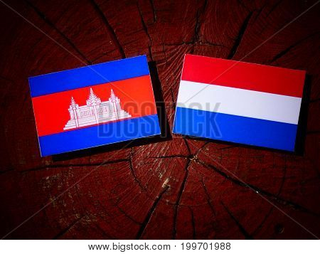Cambodian Flag With Dutch Flag On A Tree Stump Isolated