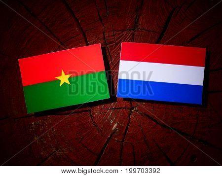 Burkina Faso Flag With Dutch Flag On A Tree Stump Isolated
