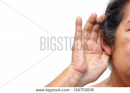 Old woman paying attention to listening sound Age-related hearing loss problem in elderly.