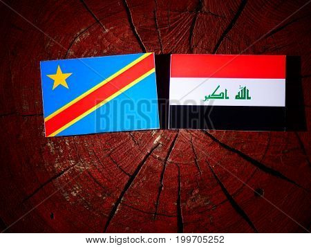 Democratic Republic Of The Congo Flag With Iraqi Flag On A Tree Stump Isolated