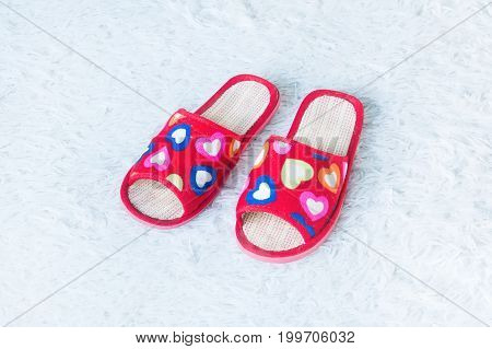 Pink Slippers On White Doormat