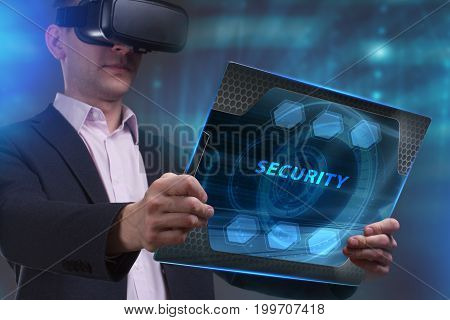 Business Technology Internet and network concept. Young businessman working on a virtual screen of the future and sees the inscription: Security