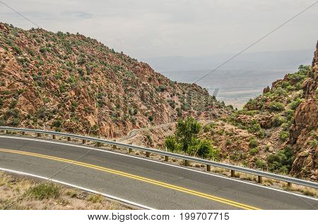 Part of Arizona Highway 89A with beautiful views of nature the highway and the valley below