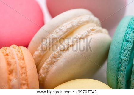Closeup Of Colorful Pastel Macaroons. Sweet Macarons.