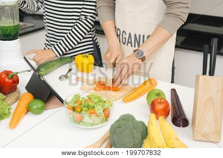 Cooking On Family Kitchen. Young And Beautiful Loving Couple Cooking And Help Each Other While Prepa