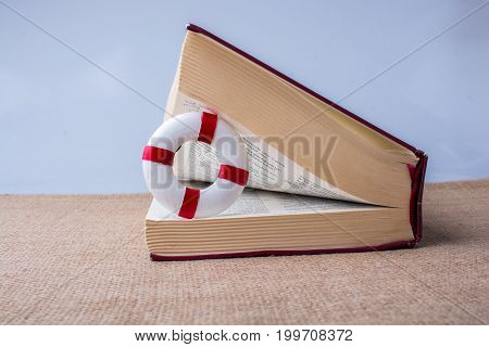 Books Half Open With A Life Saver Inside