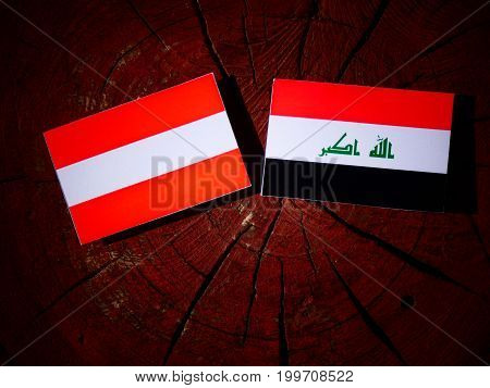 Austrian Flag With Iraqi Flag On A Tree Stump Isolated
