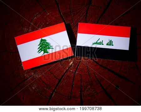 Lebanese Flag With Iraqi Flag On A Tree Stump Isolated