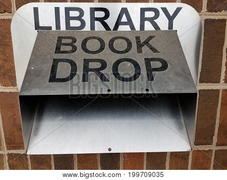 metal library book drop sign and book drop