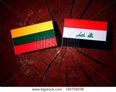 Lithuanian Flag With Iraqi Flag On A Tree Stump Isolated