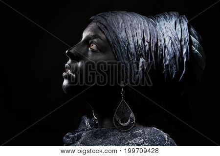 Woman with black skin in traditional turban. Studio shot