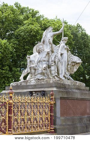Prince Albert Memorial Kensington Gardens sculpture at the base of the monument London United Kingdom. It was commissioned by Queen Victoria in memory of her husband opened in July 1872