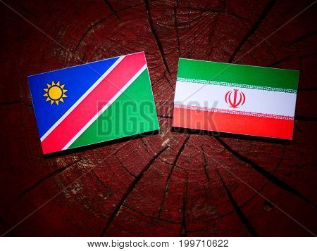 Namibian Flag With Iranian Flag On A Tree Stump Isolated