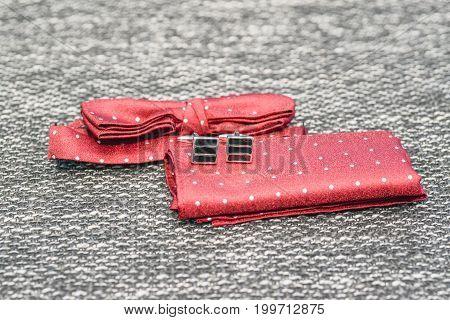 Wedding groom accessories details. Red hankerchief and cufflinks