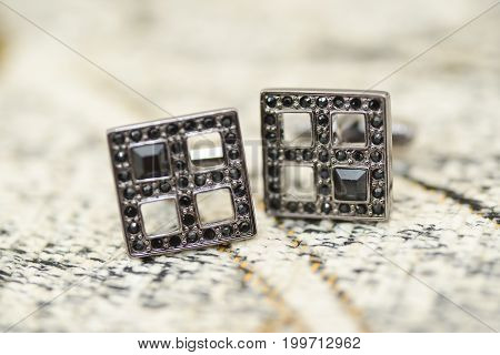 wedding groom accessories. black cuff-links details isolated