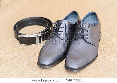 wedding accessories details. groom black belt and shoes