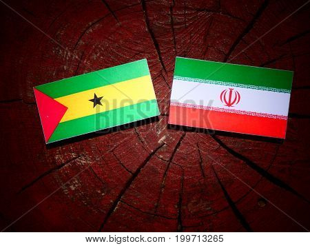 Sao Tome And Principe Flag With Iranian Flag On A Tree Stump Isolated