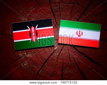 Kenyan Flag With Iranian Flag On A Tree Stump Isolated