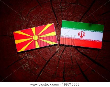 Macedonian Flag With Iranian Flag On A Tree Stump Isolated