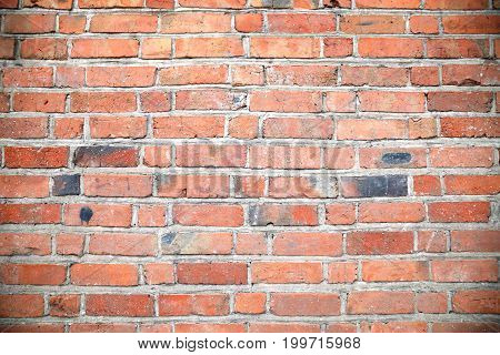 stonewall background of red old brick, texture