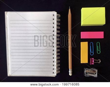 School supplies, stationery accessories on black background. Top view stock photo in back to school concept.