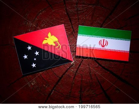 Papua New Guinea Flag With Iranian Flag On A Tree Stump Isolated