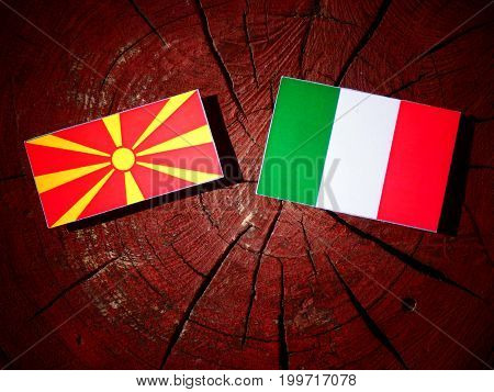 Macedonian Flag With Italian Flag On A Tree Stump Isolated
