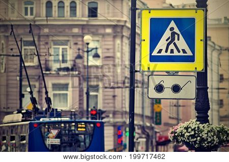 the photo with effect of a retro the street sign or the road sign the crosswalk and transition for blind people on the city street