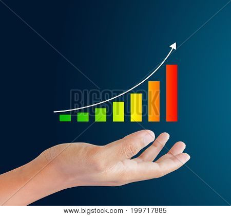 colorful Graphs on the hand on blue background