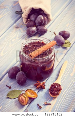 Vintage Photo, Plum Marmalade Or Jam In Glass Jar, Fruits And Spices On Boards, Sweet Dessert Concep