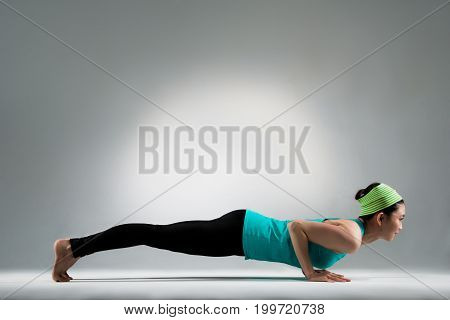 Gymnastic Female Player Lying On The Ground Floor