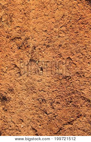 Red clay earthen wall texture background texture
