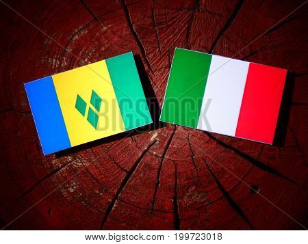 Saint Vincent And The Grenadines Flag With Italian Flag On A Tree Stump Isolated
