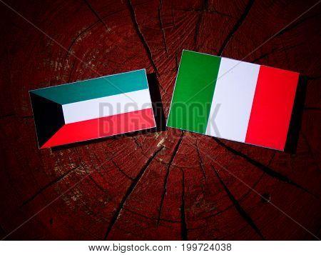 Kuwaiti Flag With Italian Flag On A Tree Stump Isolated