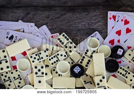 Various board games chess board, playing cards, dominoes. Hobby. Metaphor for games and gambling.