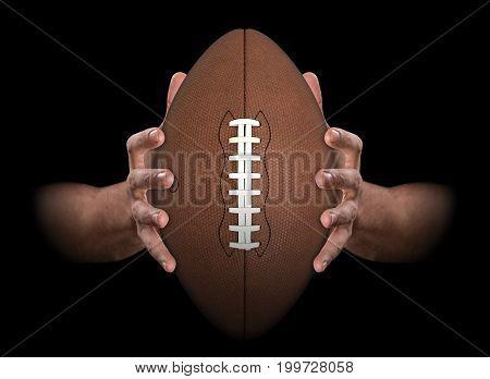 Hands Gripping Football