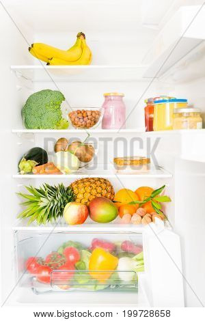 fridge filled with mostly vegetables and fruit, some soy products too.