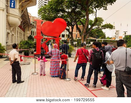 Kuala Lumpur Malaysia - April 22 2017: Tourists queuing up for posing with the