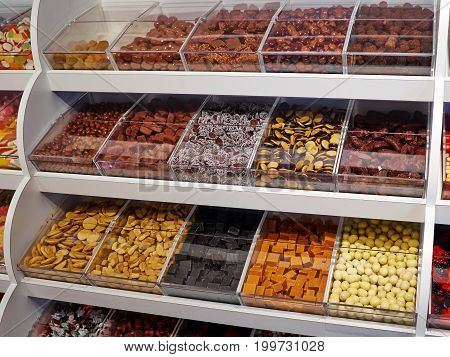 Selection of colorful candies and jellies on sales display in a shop