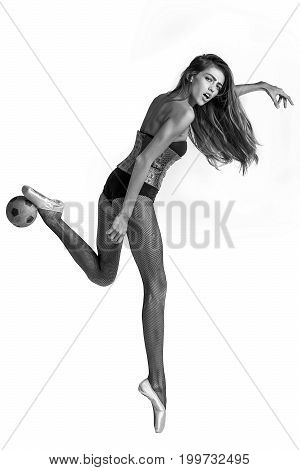 football player or woman ballerina with long hair and legs in pointe shoes and body suit with ball black and white