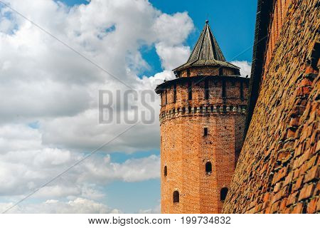 Landscape with Marinkin tower of kremlin in Kolomna, Moscow region in summer sunny day. Blue sky, white clouds. Red bricks wall of ancient castle 16th century. Cityscape for posters, prints, design.