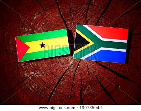 Sao Tome And Principe Flag With South African Flag On A Tree Stump Isolated