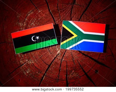 Libyan Flag With South African Flag On A Tree Stump Isolated