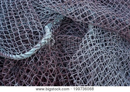 old fishing net piled on the ground
